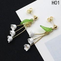 Boucles d'oreilles boutons fleurs de lys