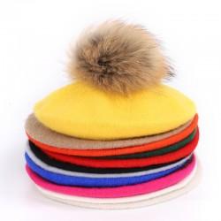 Elegant beret with fur pom-pom